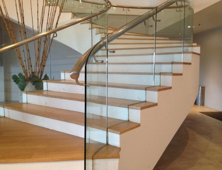 Curved Glass Railing with Wood Handrail.
